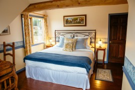 The 'Frontier' master bedroom -  2-room suite in the main Ranch House offers luxury lodging in the wilderness at Siwash Lake