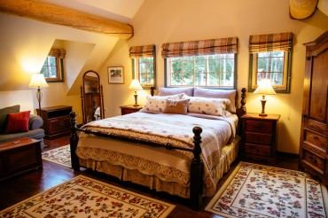 Master bedroom in the 'The Siwash' Ranch House Suite, Siwash Lake Wilderness Resort