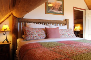 Master Bedroom in the Cariboo Barn Loft Suite at Siwash Lake Wilderness Resort