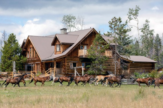 An iconic luxury wilderness lodge - the main log Ranch House at Siwash Lake