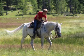 One-on-one horsemanship & beautiful riding terrain during Siwash Lake's dedicated horse program