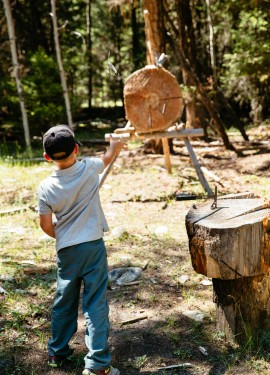 Warming up with throwing axes for the Marksmanship program at Siwash Lake Wilderness Resort