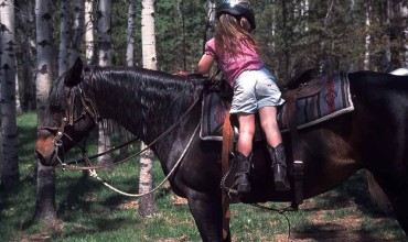 Small children can participate with their family during the SiwashSynergy™ luxury equine experience at Siwash Lake