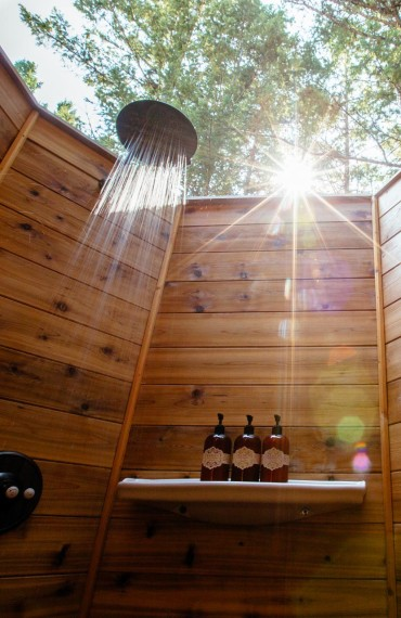 An open air shower with rain faucet coming soon at Siwash Lake.