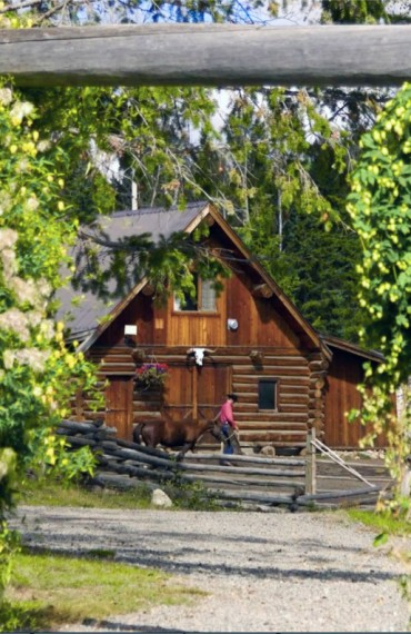 An authentic hand-hewn log barn accommodation - The Cariboo Barn Loft Suite