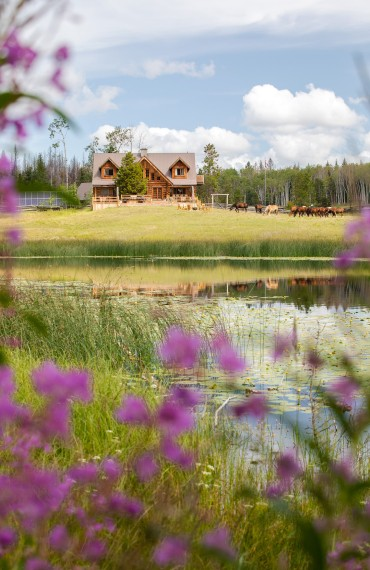 The main Ranch House and its Siwash Suite, amid a lush, verdant oasis at Siwash Lake
