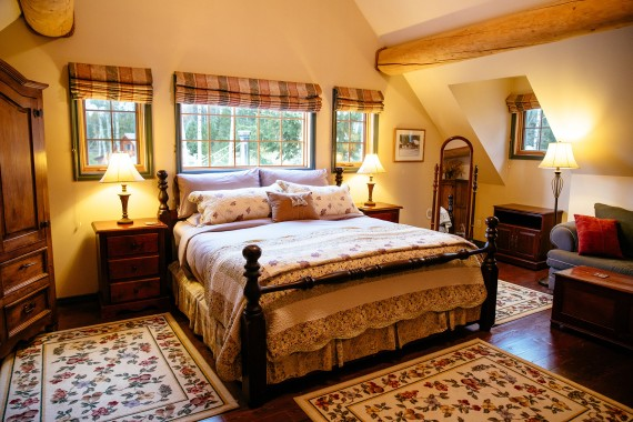 The master bedroom of the Siwash Suite in the main Ranch House at Siwash Lake